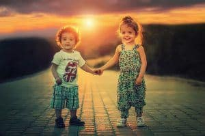 brother_sister_holding_hands