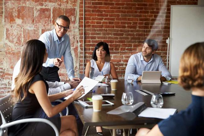 employee benefits meeting around table
