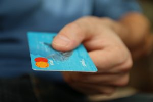man holding out bank card