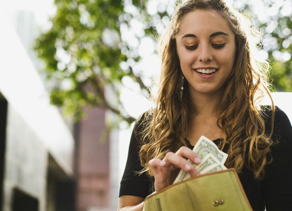 generation z woman holding cash